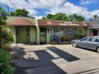 Fannon Animal Hospital 5009 Clinton Hwy, Knoxville, TN: Approx 2000 sq ft and approx 50ft Clinton Hwy Frontage and paved parking-- building has some smoke and water damage from small fire