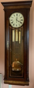 large, hanging Howard Miller grandfather clock - all 3 weights and winding key - Face 11 – 12 in; 20.5 x 68 inches; excellent condition, MODEL 612-600 -Three different chimes: Whittington, St Michaels, and West Minster- see video!