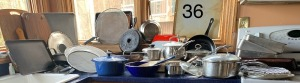 Assorted Pots, Pans, Cooking Sheets, and Cutting Boards - shows signs of use