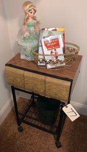 "Entertainment stand w/ metal letter basket, books, vintage music doll - plays ""Deep In The Heart of Texas"" - working"