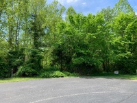 Lot 22 of Hunters Ridge (7500 Hunters Ridge Way) utility water available, very nice and well-kept double wide mobile home community — 3BR approval on a nice large wooded lot at cul-de-sac, only 2.5 miles from i40 Strawberry Plains exit. Close by restauran