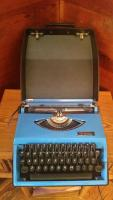 Blue Royal typewriter with case