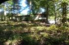 Sale 4: Court-Ordered #11-01-4577 Harrell Estate, level wooded lot w/unlivable mobile home handy Seymour TN location